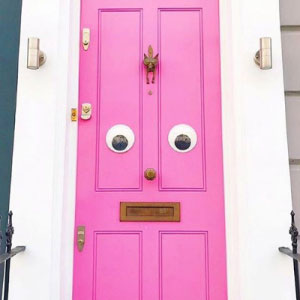 Pink door with giant googly eyes